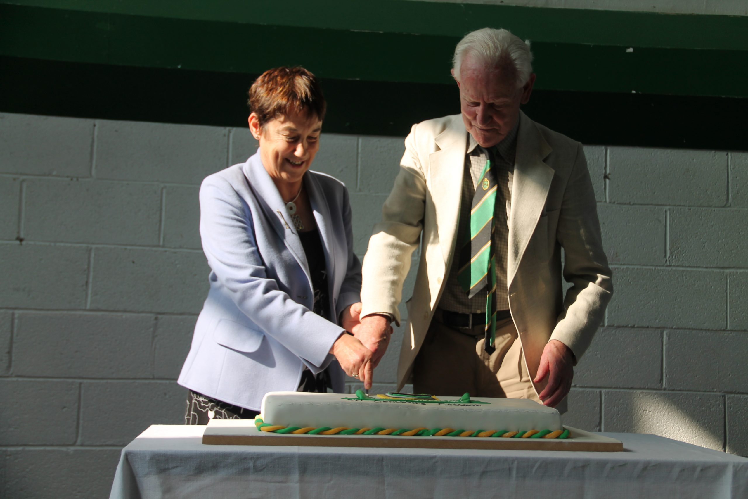 Cutting the 75th Cake with Ann Sheppard